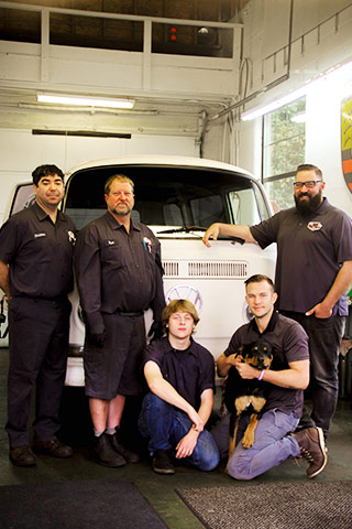 Trafton's Foreign Auto Team in Shop with VW
